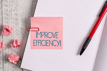 Photo for Word writing text Improve Efficiency. Business photo showcasing Competency in perforanalysisce with Least Waste of Effort Thick pages notebook stationary placed above classic look wooden backdrop - Royalty Free Image