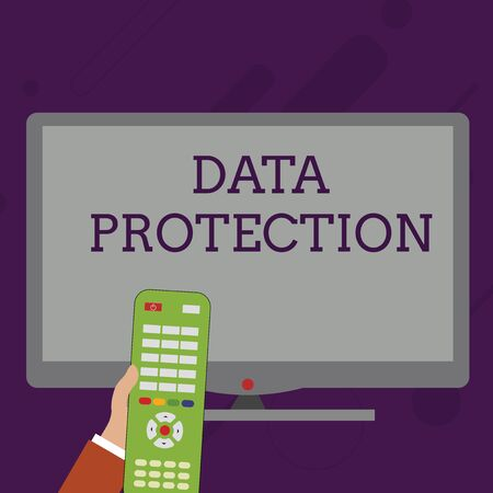 Foto de Word writing text Data Protection. Business photo showcasing Protect IP addresses and demonstratingal data from harmful software Hand Holding Computer Remote Control infront of Blank Wide Color PC Screen - Imagen libre de derechos