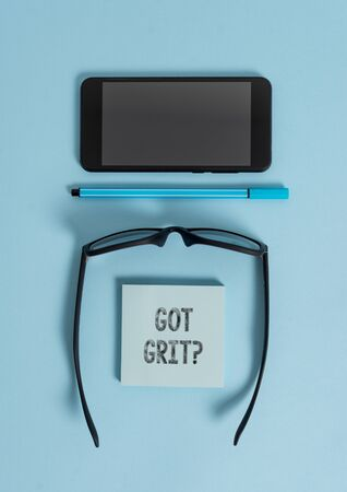 Photo pour Conceptual hand writing showing Got Grit Question. Concept meaning A hardwork with perseverance towards the desired goal Dark eyeglasses colored sticky note smartphone pastel background - image libre de droit