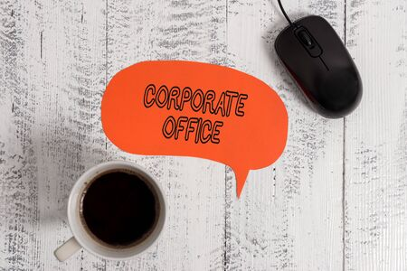 Conceptual hand writing showing Corporate Office. Concept meaning home department that support primary departments indirectly Wooden vintage table background coffee cup speech bubble