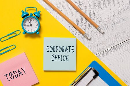 Word writing text Corporate Office. Business photo showcasing home department that support primary departments indirectly Notepads clips paper sheet clipboard markers alarm clock wooden background