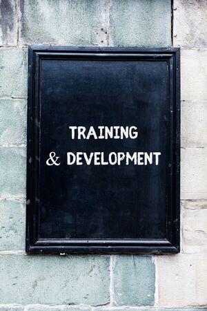 Foto de Word writing text Training And Development. Business photo showcasing learn specific knowledge to improve perforanalysisce - Imagen libre de derechos