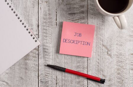 Foto de Handwriting text Job Description. Conceptual photo a formal account of an employee s is responsibilities Stationary placed next to a cup of black coffee above the wooden table - Imagen libre de derechos