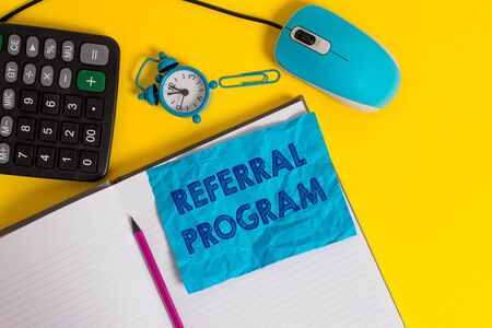 Writing note showing Referral Program. Business concept for employees are rewarded for introducing suitable recruits Notebook calculator mouse pencil alarm clock sheet color background