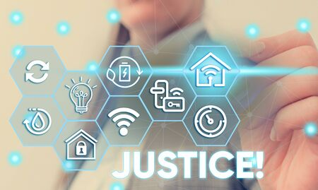 Conceptual handwriting showing Justice. Concept meaning impartial adjustment of conflicting claims or assignments Female human wear formal work suit presenting smart device