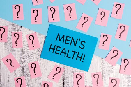 Foto de Word writing text Men S Health. Business photo showcasing state of complete physical mental and social well being by analysis Scribbled and crumbling papers with thick cardboard above wooden table - Imagen libre de derechos