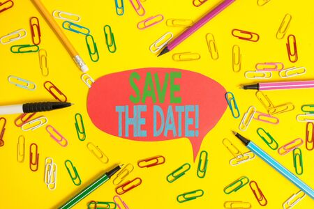 Foto de Word writing text Save The Date. Business photo showcasing remember not schedule anything else on this day Flat lay above empty paper with copy space pencils and colored paper clips - Imagen libre de derechos