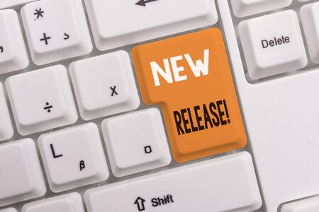Photo pour Text sign showing New Release. Business photo text announcing something newsworthy recent product White pc keyboard with empty note paper above white background key copy space - image libre de droit