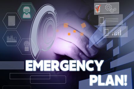 Photo pour Text sign showing Emergency Plan. Business photo showcasing actions developed to mitigate damage of potential events Male human wear formal work suit presenting presentation using smart device - image libre de droit