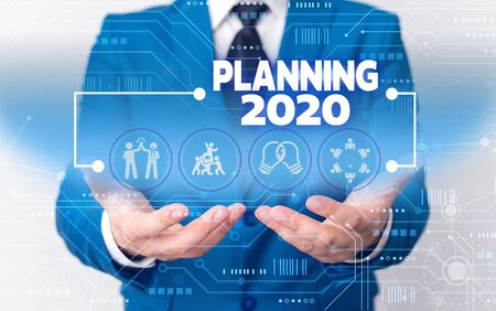 Photo pour Word writing text Planning 2020. Business photo showcasing Begin with end in the Mind Positioning Long term Objectives Male human wear formal work suit presenting presentation using smart device - image libre de droit