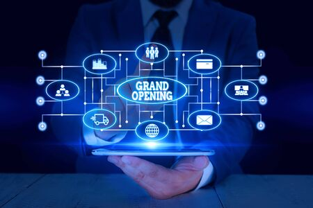 Foto de Text sign showing Grand Opening. Business photo text Ribbon Cutting New Business First Official Day Launching Male human wear formal work suit presenting presentation using smart device - Imagen libre de derechos