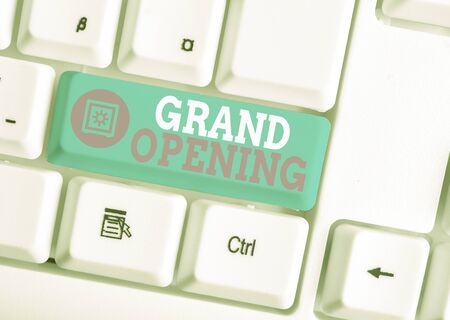 Foto de Writing note showing Grand Opening. Business concept for Ribbon Cutting New Business First Official Day Launching White pc keyboard with note paper above the white background - Imagen libre de derechos