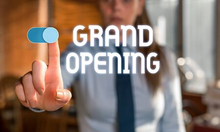 Foto de Text sign showing Grand Opening. Business photo showcasing Ribbon Cutting New Business First Official Day Launching Blurred woman in the background pointing with finger in empty space - Imagen libre de derechos