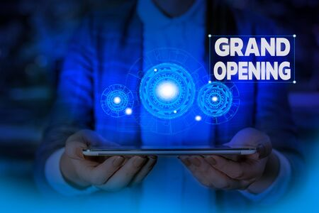 Foto de Handwriting text writing Grand Opening. Conceptual photo Ribbon Cutting New Business First Official Day Launching Woman wear formal work suit presenting presentation using smart device - Imagen libre de derechos