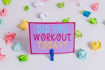 Foto de Writing note showing Did You Workout Today. Business concept for asking if made session physical exercise Colored crumpled paper empty reminder white floor clothespin - Imagen libre de derechos