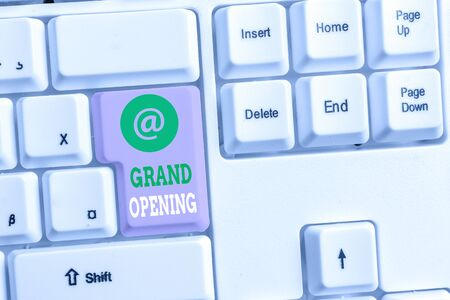 Foto de Text sign showing Grand Opening. Business photo text Ribbon Cutting New Business First Official Day Launching White pc keyboard with empty note paper above white background key copy space - Imagen libre de derechos