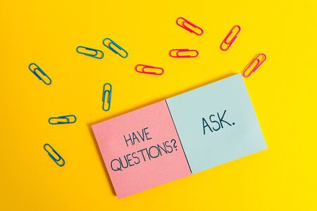 Photo for Writing note showing Have Questionsquestion Ask. Business concept for something that you say or write to ask a demonstrating Colored square blank sticky notepads sheets clips color background - Royalty Free Image