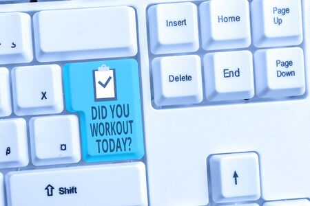 Foto de Handwriting text writing Did You Workout Today. Conceptual photo asking if made session physical exercise White pc keyboard with empty note paper above white background key copy space - Imagen libre de derechos