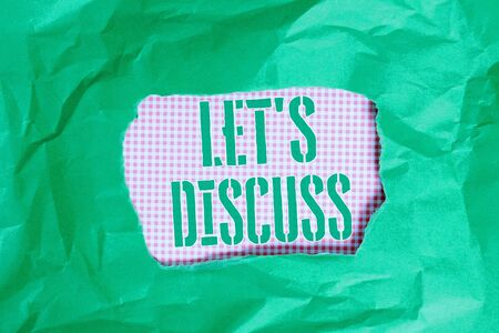 Text sign showing Let S Discuss. Business photo showcasing Permit to Talk Open Up Go Over a Topic Chat Sharing Green crumpled ripped colored paper sheet centre torn colorful background