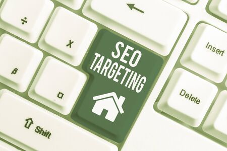 Conceptual hand writing showing Seo Targeting. Concept meaning Specific Keywords for Location Landing Page Top Domain White pc keyboard with note paper above the white background