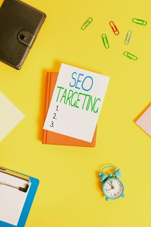 Handwriting text Seo Targeting. Conceptual photo Specific Keywords for Location Landing Page Top Domain Paper clips with blank papers for text messages