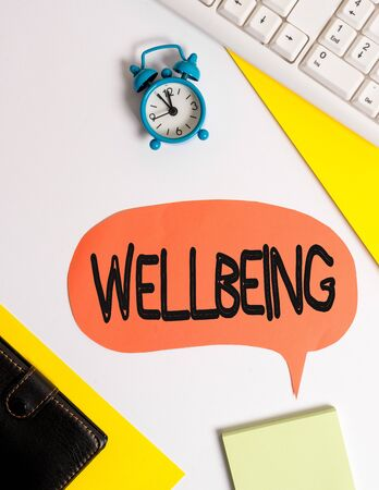 Photo pour Word writing text Wellbeing. Business photo showcasing A good or satisfactory condition of existence including health Flat lay with copy space on bubble paper clock and paper clips - image libre de droit