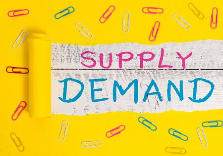 Writing note showing Supply Deanalysisd. Business concept for Relationship between the amounts available and wanted