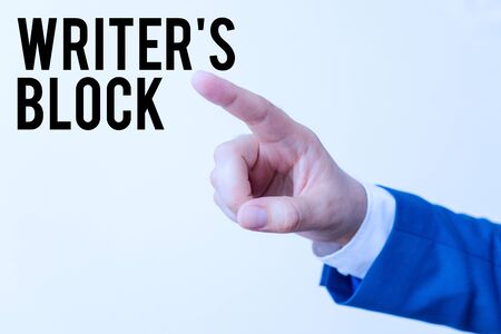 Writing note showing Writer S Block. Business concept for Condition of being unable to think of what to write Isolated hand pointing with finger. Business concept pointing finger