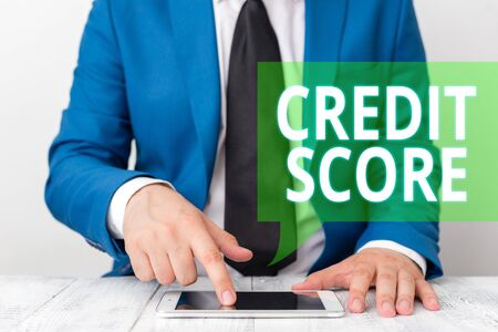 Photo pour Conceptual hand writing showing Credit Score. Concept meaning Represent the creditworthiness of an individual Lenders rating Businessman in blue suite with a tie holds lap top in hands - image libre de droit