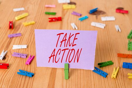 Photo pour Handwriting text Take Action. Conceptual photo Supporting what you say not just words but through evidence Colored clothespin papers empty reminder wooden floor background office - image libre de droit