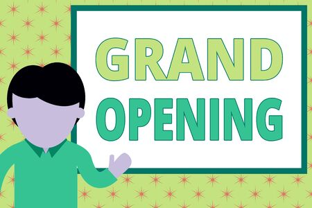 Foto de Handwriting text writing Grand Opening. Conceptual photo Ribbon Cutting New Business First Official Day Launching Young man standing in front whiteboard pointing to project. photo Art - Imagen libre de derechos