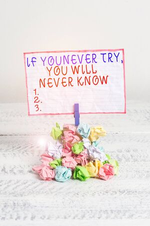 Foto de Conceptual hand writing showing If You Never Try You Will Never Know. Concept meaning Inspiration to make new thing Reminder pile colored crumpled paper clothespin wooden space - Imagen libre de derechos