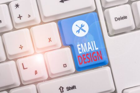 Photo pour Conceptual hand writing showing Email Design. Concept meaning reusable HTML file that is used to build email campaigns Keyboard with note paper on white background key copy space - image libre de droit