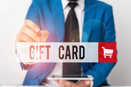 Word writing text Gift Card. Business photo showcasing A present usually made of paper that contains your message Businessman pointing with pen in empty copy space