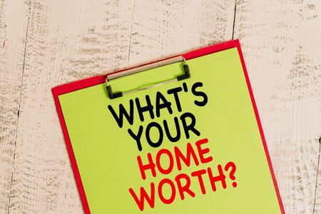 Foto für Word writing text What S Your Home Worth Question. Business photo showcasing Value of a house Property Cost Price Rate Colored clipboard blank paper sheet old retro wooden vintage background - Lizenzfreies Bild
