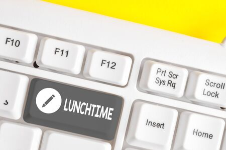 Writing note showing Lunchtime. Business concept for Meal in the middle of the day after breakfast and before dinner White pc keyboard with note paper above the white background