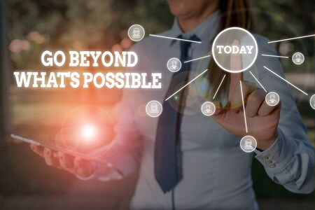 Writing note showing Go Beyond What S Possible. Business concept for do bigger things You can reach dreams Woman wear formal work suit presenting presentation using smart device
