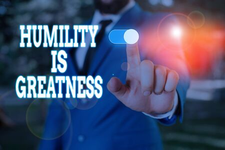 Photo for Text sign showing Humility Is Greatness. Business photo text being Humble is a Virtue not to Feel overly Superior Male human wear formal work suit presenting presentation using smart device - Royalty Free Image