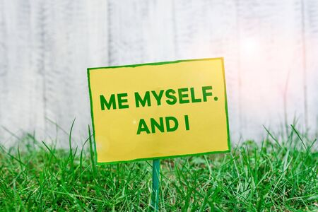 Photo pour Handwriting text writing Me Myself And I. Conceptual photo used by speaker to refer to herself as the object of a verb Plain empty paper attached to a stick and placed in the green grassy land - image libre de droit
