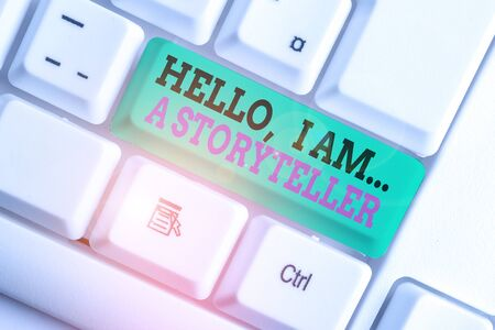 Photo pour Handwriting text writing Hello I Am A Storyteller. Conceptual photo introducing yourself as novels article writer White pc keyboard with empty note paper above white background key copy space - image libre de droit