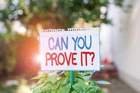 Photo pour Word writing text Can You Prove It Question. Business photo showcasing Asking Someone for evidence or approval Court Plain empty paper attached to a stick and placed in the green leafy plants - image libre de droit