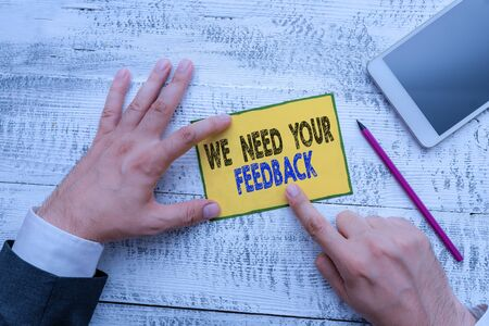 Foto de Word writing text We Need Your Feedback. Business photo showcasing Give us your review thoughts comments what to improve - Imagen libre de derechos