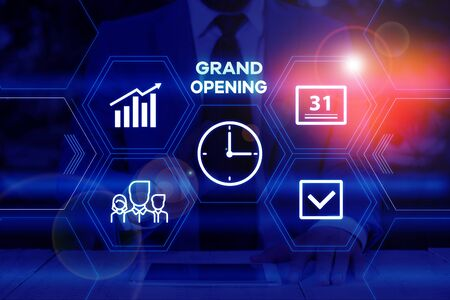 Photo for Handwriting text writing Grand Opening. Conceptual photo Ribbon Cutting New Business First Official Day Launching Male human wear formal work suit presenting presentation using smart device - Royalty Free Image