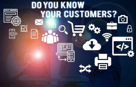Photo for Text sign showing Do You Know Your Customers question. Business photo showcasing asking to identify a customer s is nature Male human wear formal work suit presenting presentation using smart device - Royalty Free Image
