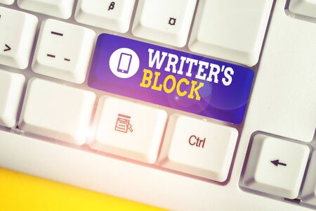 Handwriting text Writer S Block. Conceptual photo Condition of being unable to think of what to write White pc keyboard with empty note paper above white background key copy space
