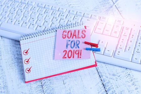 Photo pour Writing note showing Goals For 2019. Business concept for object of demonstratings ambition or effort aim or desired result notebook reminder clothespin with pinned sheet light wooden - image libre de droit