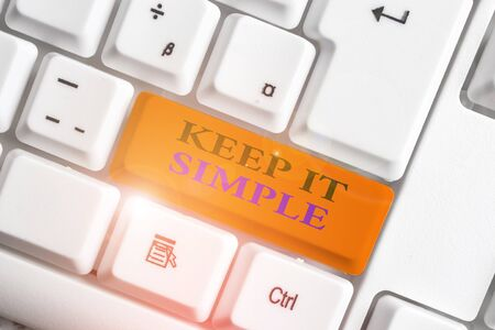 Photo pour Word writing text Keep It Simple. Business photo showcasing to make something easy to understand and not in fancy way White pc keyboard with empty note paper above white background key copy space - image libre de droit