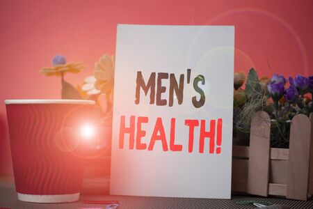 Foto de Word writing text Men S Health. Business photo showcasing state of complete physical mental and social well being by analysis Flowers and stationary plus plain sheet with paper big cup above a table - Imagen libre de derechos
