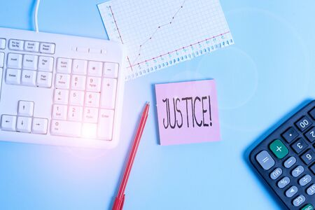 Word writing text Justice. Business photo showcasing impartial adjustment of conflicting claims or assignments Paper blue desk computer keyboard office study notebook chart numbers memo