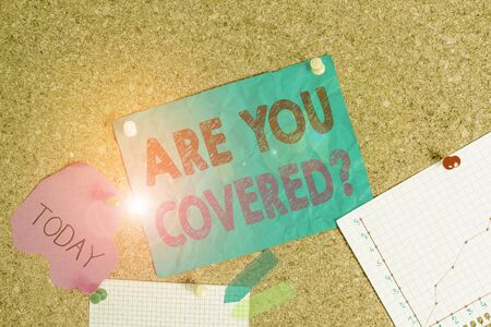 Foto de Conceptual hand writing showing Are You Covered Question. Concept meaning asking showing if they had insurance in work or life Corkboard size paper thumbtack sheet billboard notice board - Imagen libre de derechos